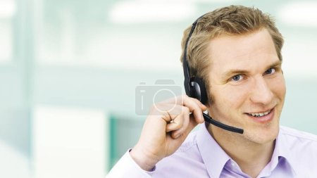 Businessman adjusting headset with microphone