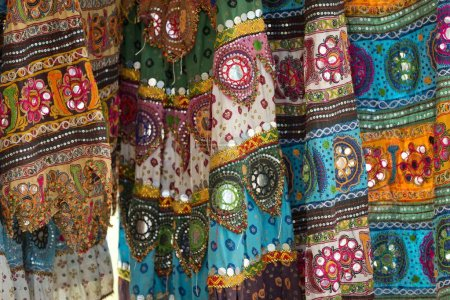 Colourful skirts inlaid with mirrors and different patterns