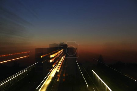 Photo for Sunset and blurred motion of speed lights - Royalty Free Image