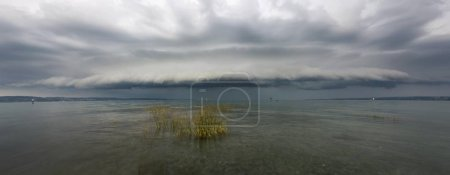 Thundercloud with storm and waves on Lake Constance near Konstanz, Baden-Wuerttemberg, Germany, Europe
