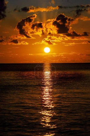 Photo for Orange sun in sky, sea and sunset - Royalty Free Image