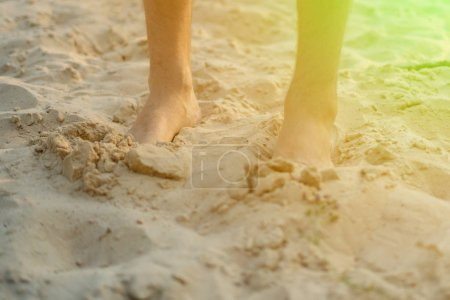 Photo for Bare male feet walk on the sandy beach, healthy yoga practice concept - Royalty Free Image