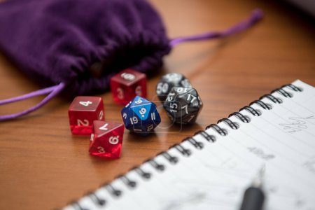 Set of pen, notebook, and dices to play role game ...