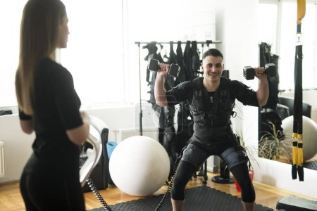 an athlete doing exercise in ems fitness studio