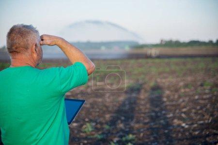 Male farmer uses modern technology in the field