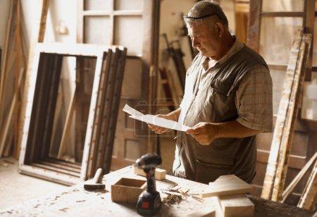 Carpenters at work in his workshop