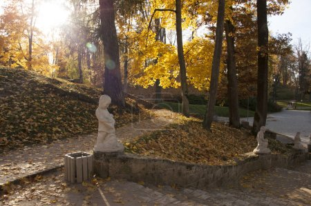 White figures along stairs in autumn park at daytime