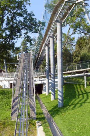 Bobsleigh track ramp with protective cage, fun resort
