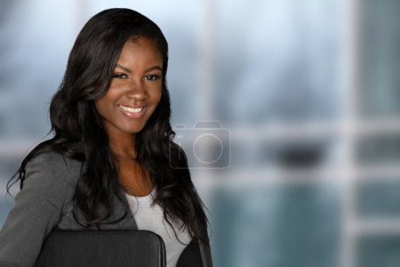 Photo for Young pretty african american businesswoman at her job - Royalty Free Image