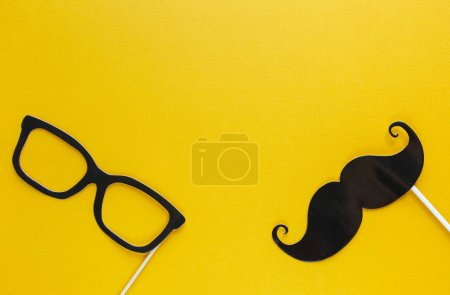 Moustache photo booth props on blue background. Moustache cut outs. Movember Movement. Prostate Cancer Awareness, Men's health awareness concept. flat lay, top view, copyspace