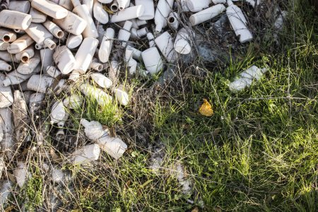 Many white plastic waste on grass. Industrial waste