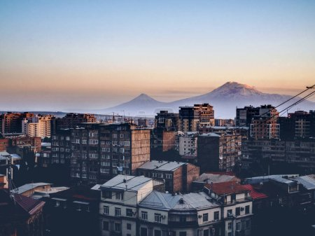 Photo for Aerial view of Yerevan city on twilight with mountains on background, Armenia - Royalty Free Image