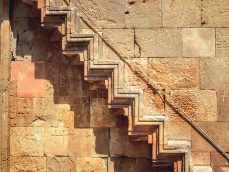 Photo for Full frame shot of stone wall with decor in shape of stairs - Royalty Free Image