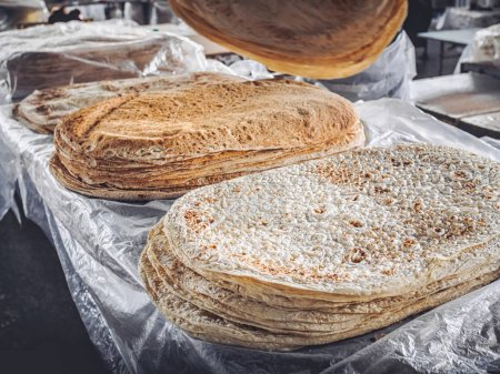 Photo for Stacks of lavash bread selling on farmers market at Armenia - Royalty Free Image