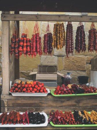 sweet tasty churchkhela hanging on threads at georgian market