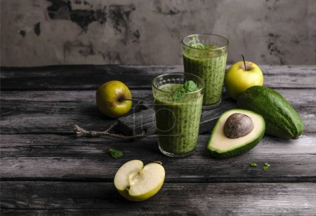 Photo for Green detox smoothie with avocado on rustic wooden board - Royalty Free Image