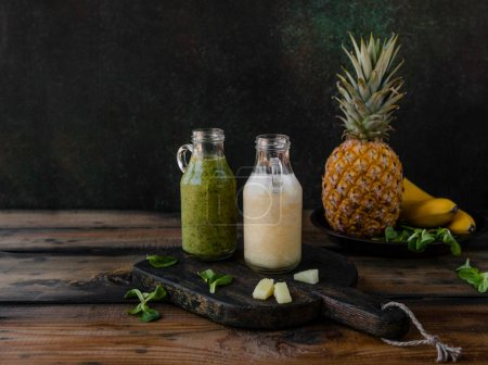 Delicious exotic fruits smoothie on rustic wooden board