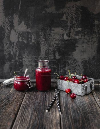 Fresh healthy smoothie on rustic table with cherries and straws