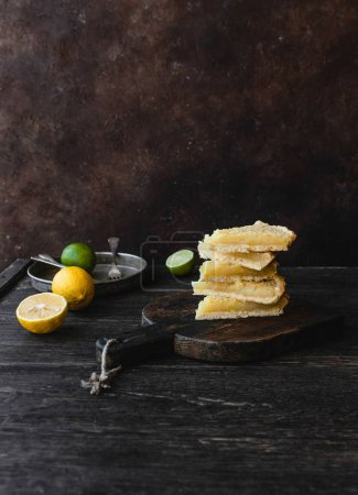 pieces of delicious lemon pie on cutting board
