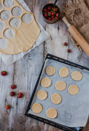 Photo for Top view of dough and strawberries for cookies on table - Royalty Free Image