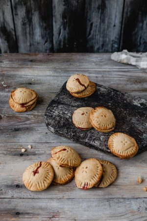 tasty cooked cookies on wooden table