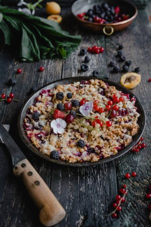 Photo for Appetizing pie with berries on wooden table - Royalty Free Image