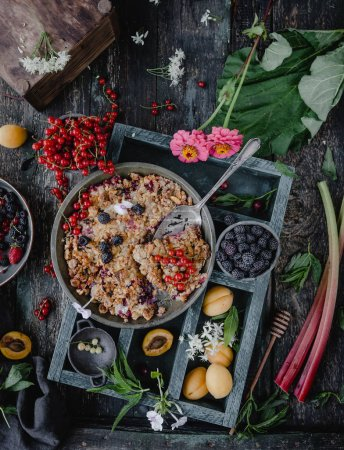 Photo for Top view of tasty pie with berries on wooden tray - Royalty Free Image