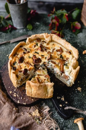 Photo for Cooked appetizing pie with mushrooms on wooden table - Royalty Free Image