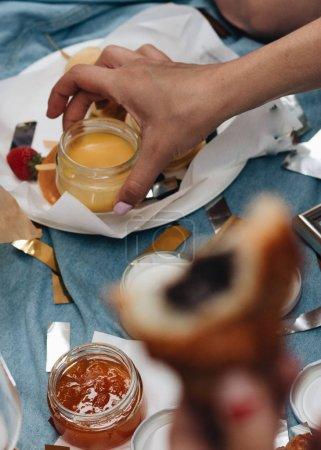Photo for Female hand taking jar of honey - Royalty Free Image