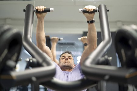 Photo for Strong man training in gym the top train. - Royalty Free Image