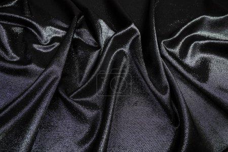 Foto de Tela del brocado negro en los pliegues de la tabla - Imagen libre de derechos