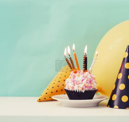 Photo for Birthday cake with candles and cone hats in vintage color, copy space - Royalty Free Image