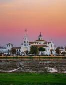El Rocio village church at dusk with pink sky