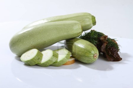Zucchini, courgettes on a white background.