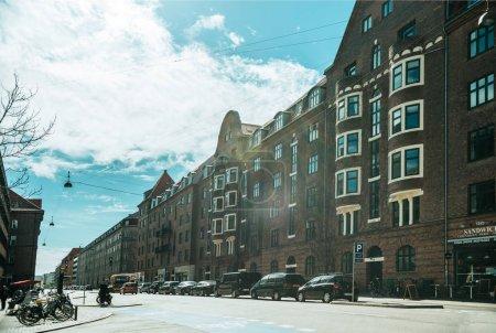 COPENHAGEN, DENMARK - MAY 5, 2018: urban scene with cloudy sky, city street and buildings in copenhagen, denmark