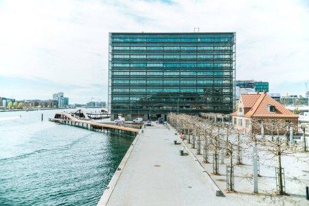 COPENHAGEN, DENMARK - MAY 6, 2018: urban scene with city river and buildings in copenhagen, denmark