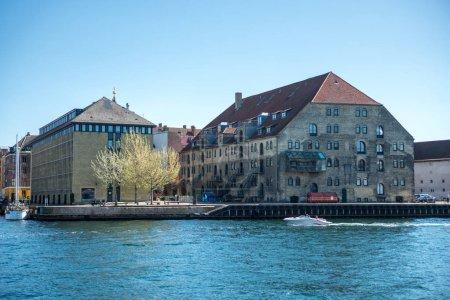 COPENHAGEN, DENMARK - MAY 5, 2018: urban scene with city river and buildings in copenhagen, denmark