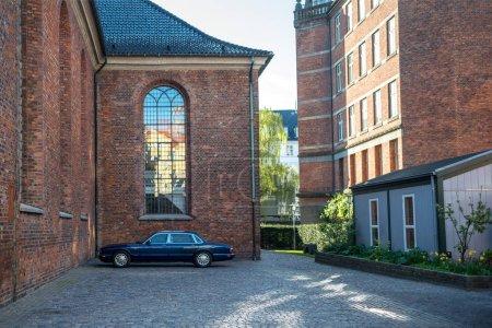 Photo for COPENHAGEN, DENMARK - MAY 6, 2018: close up view of parked black car on street in copenhagen, denmark - Royalty Free Image