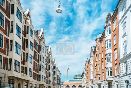 urban scene with beautiful architecture of copenhagen and cloudy sky, denmark