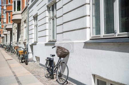 urban scene with bicycles parked on street in copenhagen, denmark