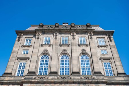 low angle view of historical Christiansborg Palace and clear blue sky, copenhagen, denmark