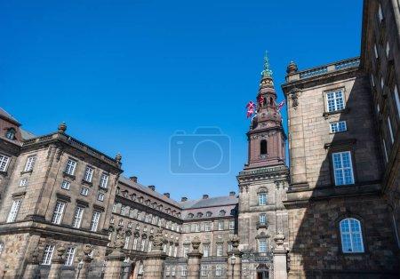 urban scene with historical Christiansborg Palace in copenhagen, denmark