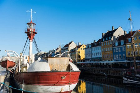 COPENHAGEN, DENMARK - 06 MAY, 2018: Nyhavn pier with color buildings, ships, yachts and other boats in the Old Town of Copenhagen, Denmark