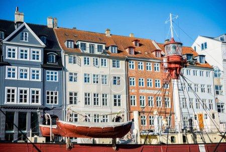 COPENHAGEN, DENMARK - 06 MAY, 2018: Nyhavn pier with buildings and boats in the Old Town of Copenhagen, Denmark