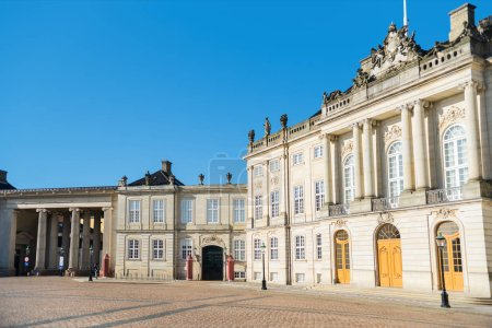 beautiful Amalienborg Square with historical buildings and columns at sunny day, copenhagen, denmark
