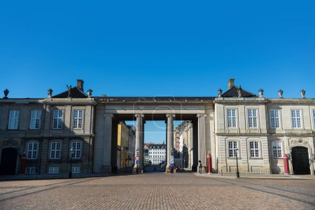 COPENHAGEN, DENMARK - MAY 6, 2018: Columns and historical buildings on square with pavement, copenhagen, denmark