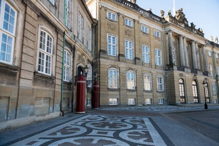 old buildings with columns and decorations on historical Amalienborg Square in copenhagen, denmark