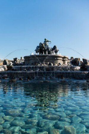 Photo for Low angle view of famous Gefion Fountain against blue sky in copenhagen, denmark - Royalty Free Image