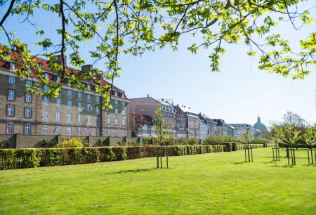 Photo for Beautiful green lawn with bushes and old buildings in copenhagen, denmark - Royalty Free Image