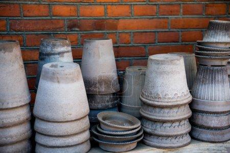 stacks of various handmade ceramic pots on shelf